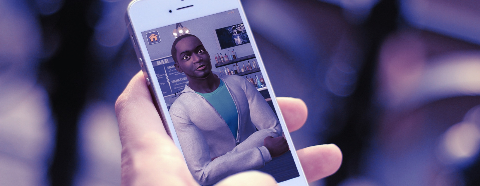 Hand holding phone with screenshot of Tough Talks virtual reality avatar of a Black man in a green shirt and gray hoodie sitting at a bar